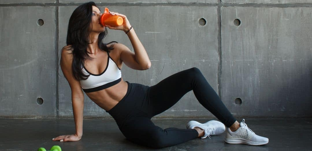 Woman drinking shake to lose belly fat